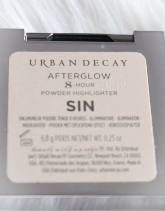 swatch highlighter afterglow urban decay sin